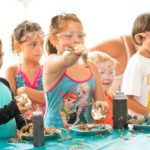 Ready. Set. Food Fight!  A group of kids at the 2016 Muddy Puddles Mess Fest gather in the food fight tent to participate in this rite of passage  One that is otherwise strictly forbidden any other time of the year.