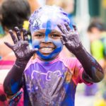 This little girl gives an entirely new meaning to finger painting at the 2016 Muddy Puddles Mess Fest, July 30th at Kiwi Country Day Camp.
