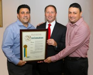 Westchester County Executive, Robert Astorino, presents the proclamation to owners John Ruggiero and Ray Sassano.