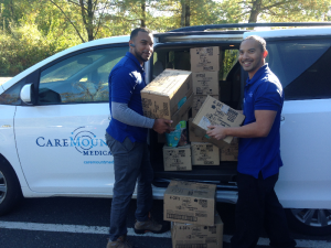 CareMount Medical employees load donated diapers for Hurricane Maria efforts