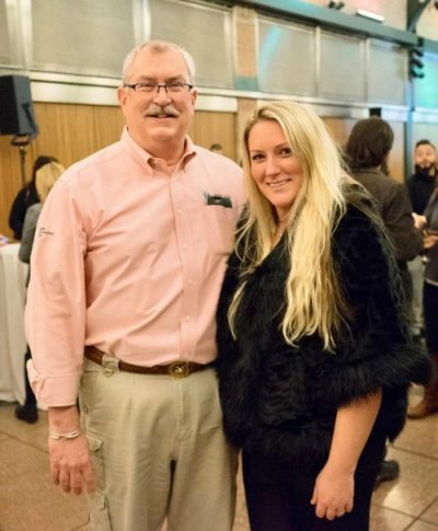 "Jim Breheny, Director of the Bronx Zoo with Dr. Marie O'Connor, President of Nordic Edge celebrating at the second season premiere party for ""The Zoo"" at the Bronx Zoo."